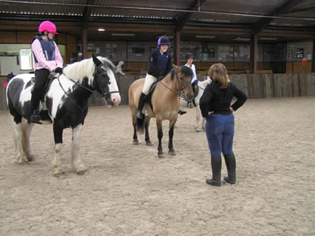 Instructor and student on horses